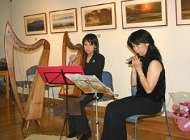 Mrs. Kiyoko Yoshida Playing the Harp
