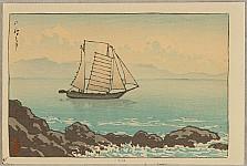 Sailboat near Rocky Coastline